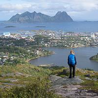 Hiker looking at the town of Svolvær in the Lofoten